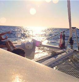 Photo of Small-Group Catamaran Cruise in Santorini with BBQ Lunch and Drinks