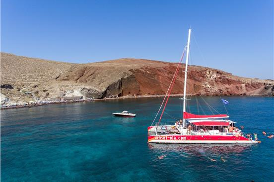 Photo of Catamaran Boat Tour in Santorini with BBQ and Drinks