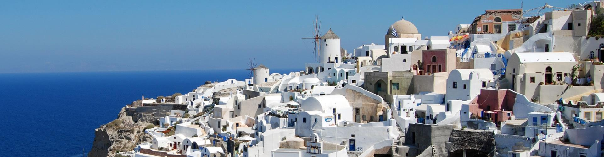 Why are most houses white painted in Santorini?