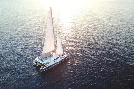 Photo of Romantic Catamaran Cruise in Santorini with lunch or dinner on board