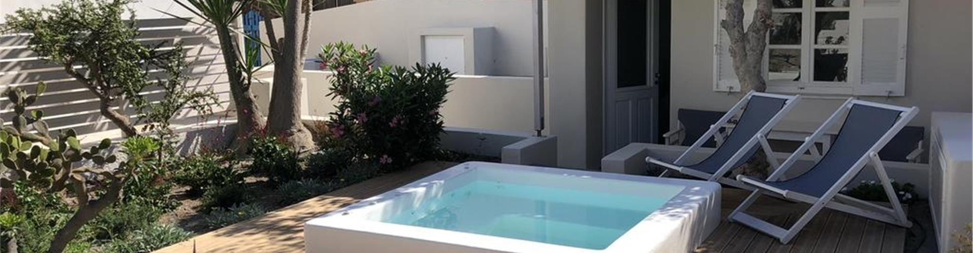 Photo of The Garden House in Oia with hot tub, Caldera Houses